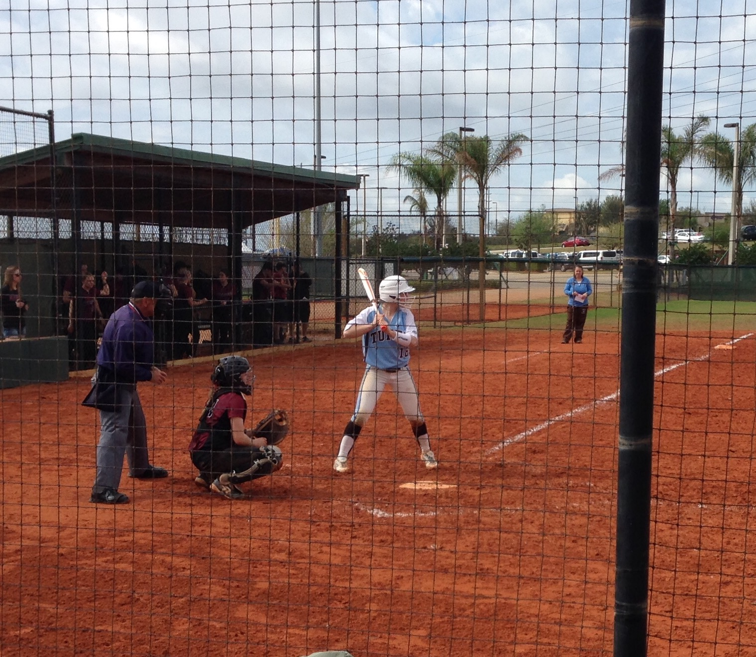 That's me! Hitting for the very first time in my college career. That's Coach in the background.